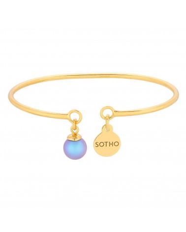 Złota bransoletka z niebieską perłą