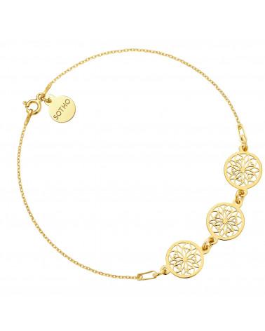 Złota bransoletka na nogę z rozetkami