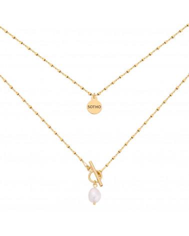 Złoty kosteczkowy naszyjnik z ozdobnym zapięciem i perłą