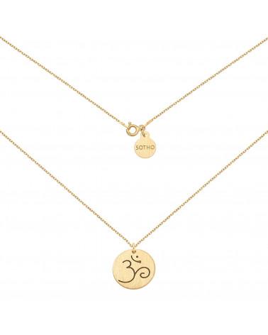 Złoty medalion z symbolem OM