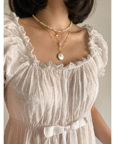 Srebrny naszyjnik z pereł  naturalnych zdobiony księżycem