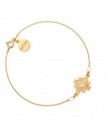 Złota bransoletka z rozetką