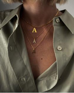Złote długie kolczyki z medalionem i kryształem SWAROVSKI® CRYSTAL