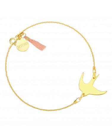 Złota bransoletka z jaskółką zdobiona  chwostem