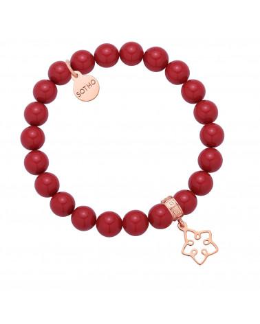 Czerwona bransoletka z pereł SWAROVSKI® CRYSTAL z ażurową gwiazdką z różowego złota