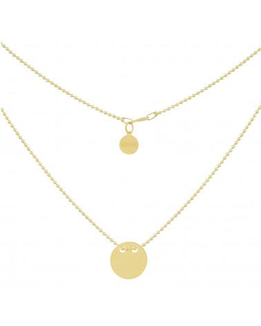 Złoty naszyjnik z pełnym kołem symbolizującym Karmę