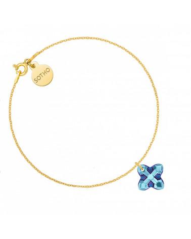 Złota bransoletka z kryształem SWAROVSKI® CRYSTAL w kolorze niebieskim