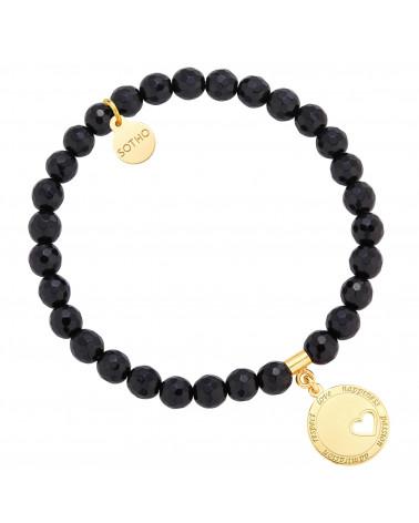 Czarna bransoletka z onyksu ze złotą zawieszką z motywującym przesłaniem